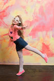 Girl doing flying swallow pose Stock Photo