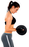Girl doing freeweights Stock Images