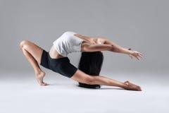 Girl doing gymnastic poses in studio Royalty Free Stock Photo