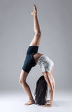 Girl doing gymnastic poses in studio Royalty Free Stock Image