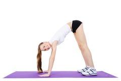 Girl doing gymnastics stock photos