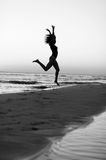 Girl doing gymnastics on the beach at sunset Royalty Free Stock Photo