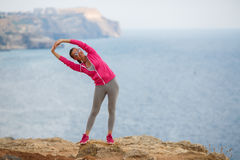 Girl doing gymnastics in the morning on the Beach Ocean Royalty Free Stock Photo