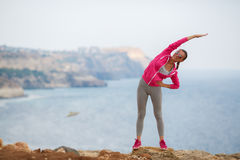 Girl doing gymnastics in the morning on the Beach Ocean Royalty Free Stock Image