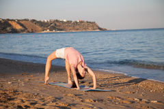 Girl doing gymnastics in the morning on the Beach Ocean Royalty Free Stock Photos
