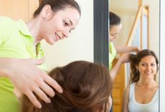 Girl doing hairstyle Stock Photography