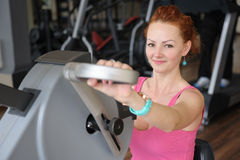 Girl doing hands spinning machine workout Stock Photo