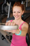 Girl doing hands spinning machine workout Stock Image