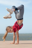 Girl doing handstand royalty free stock images
