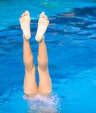 Girl doing a handstand in pool Stock Images