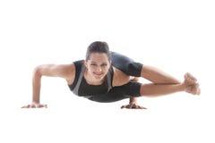 Girl doing handstand push-ups. Sporty yoga girl on white background doing handstand push-ups Royalty Free Stock Photo