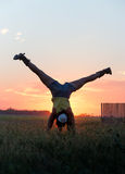 Girl doing handstand in sunset Royalty Free Stock Photography