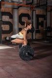 Girl doing heavy  deadlift exercise Royalty Free Stock Photos