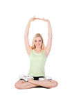 Girl doing her exercise in lotus pose Stock Photography