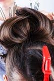 Girl doing her hair Stock Photo