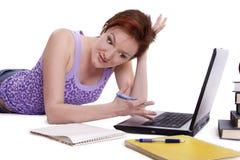 Girl doing her homework Royalty Free Stock Photo