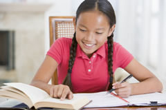 Girl Doing Her Homework Royalty Free Stock Image