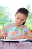 Girl doing her homework. Royalty Free Stock Photos