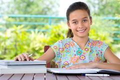 Girl doing her homework. Stock Photos