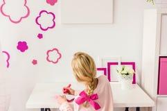 Girl doing her homework Stock Image