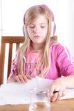 Girl doing her homework Stock Photo