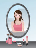 Girl doing her makeup Royalty Free Stock Photography