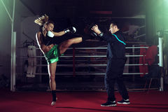 Girl doing high kick in kick boxing. Young adult women doing high kick during kickboxing training exercise Stock Photography