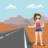 Girl Doing Hitchhiking. Beautiful young woman with backpack hitchhiking standing on road side Royalty Free Stock Images