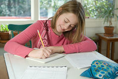 Girl doing homework Stock Images