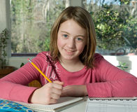 Girl doing homework Royalty Free Stock Photography