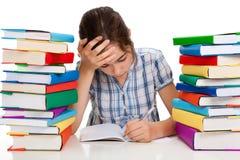 Girl doing homework Stock Image