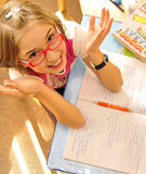Girl  doing homework. At home after school classes Royalty Free Stock Image
