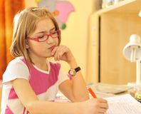Girl doing homework royalty free stock photography