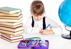 Girl is doing homework Stock Image