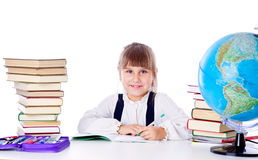 Girl is doing homework Stock Photos
