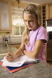 Girl doing homework Royalty Free Stock Photo