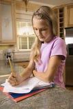 Girl doing homework royalty free stock photo