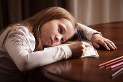 Girl doing homework Royalty Free Stock Photos