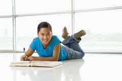 Girl doing homework. Royalty Free Stock Image