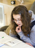 Girl doing homework Stock Photography