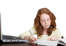 Girl doing homework Stock Photo