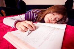 Girl doing homework Stock Photo