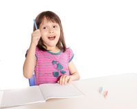 Girl doing homework having eureka moment Stock Image