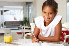 Girl Doing Homework In Kitchen Stock Images
