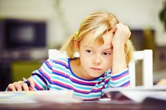 Girl is doing homework Royalty Free Stock Photography