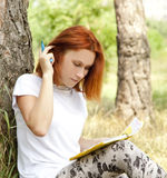 Girl doing homework at outdoor. Stock Images