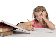 Girl Doing Homework. Pretty little girl doing her school homework Royalty Free Stock Photos