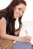 Girl doing homework smiling Stock Images