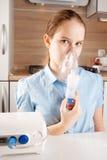 Girl doing inhalation Stock Photo
