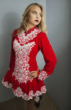 Girl doing Irish dance in red. Beautiful blond girl doing Irish dance in red and white costume Stock Images
